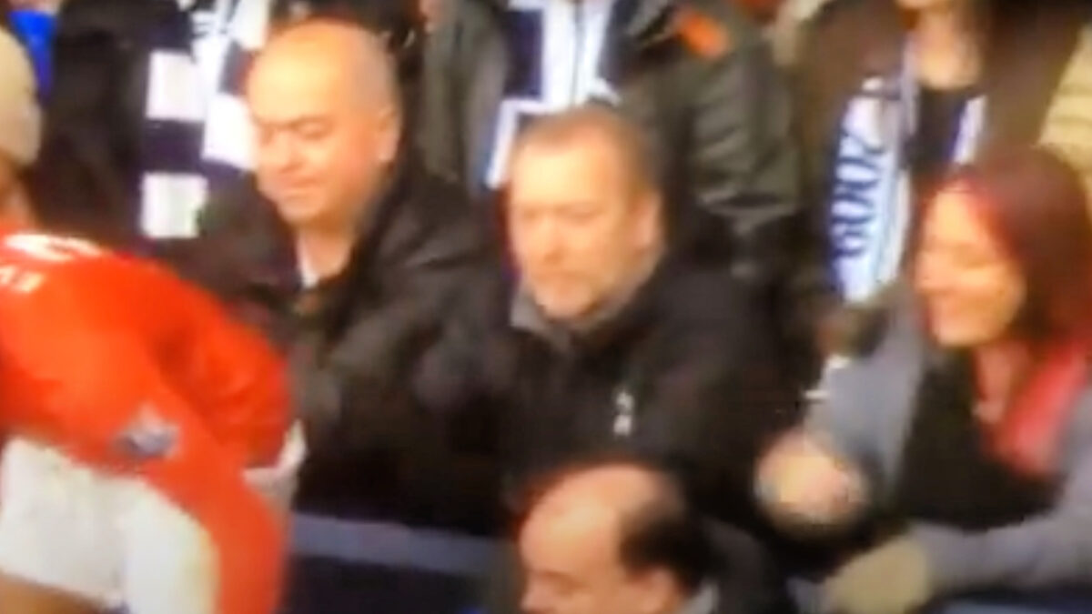 Female Tottenham fan pinches Patrice Evra on the bum