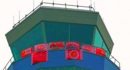 John Lennon airport control tower covered in Liverpool flags (1)