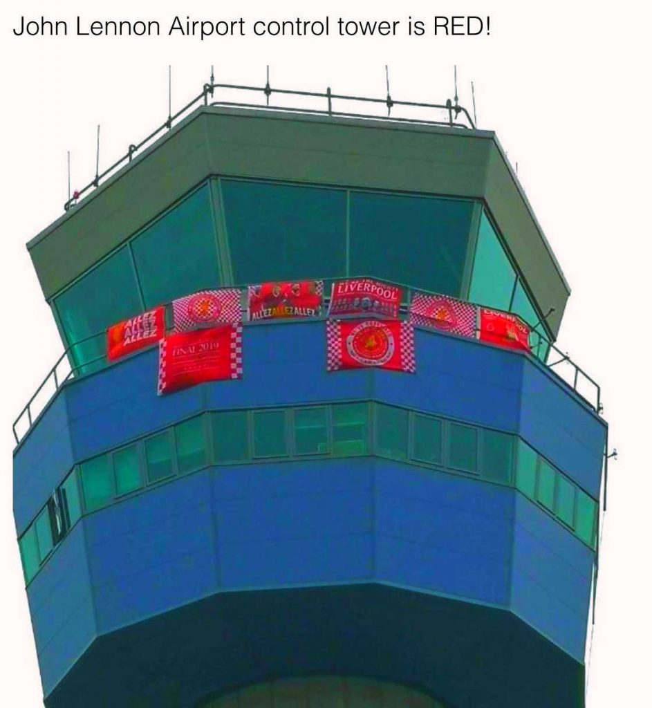 John Lennon airport control tower covered in Liverpool flags