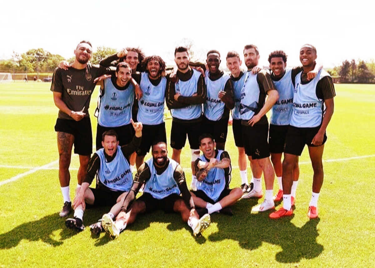 Arsenal players posing for a photo after a training game before Europa League final