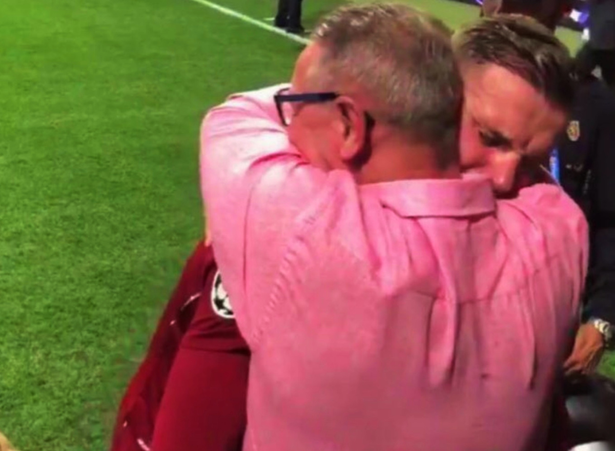 Jordan Henderson embraces his father after winning the Champions League
