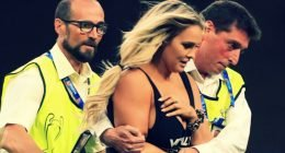 Female streaker escorted by police at the Wanda Metropolitano