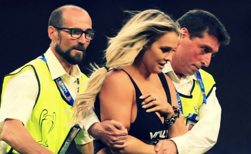 Female streaker escorted by police at the Wanda Metropolitano