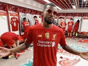 Gini Wijnaldum celebrating after winning the Premier League