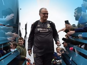 Marcelo Bielsa surrounded by Leeds United fans