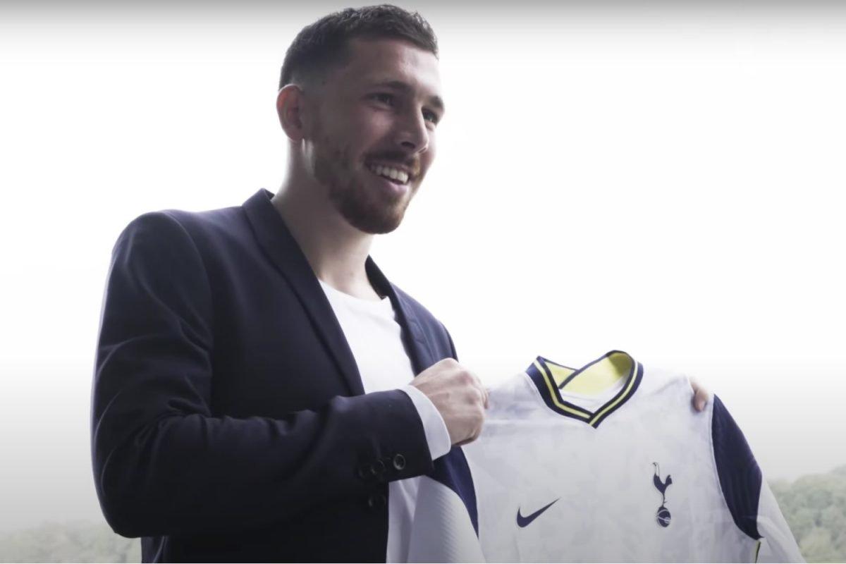 Pierre-Emile Hojbjerg holding Tottenham home kit