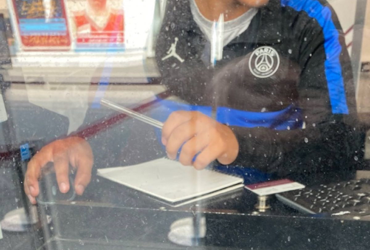 West Ham employee wearing PSG jacket while working in the ticket office
