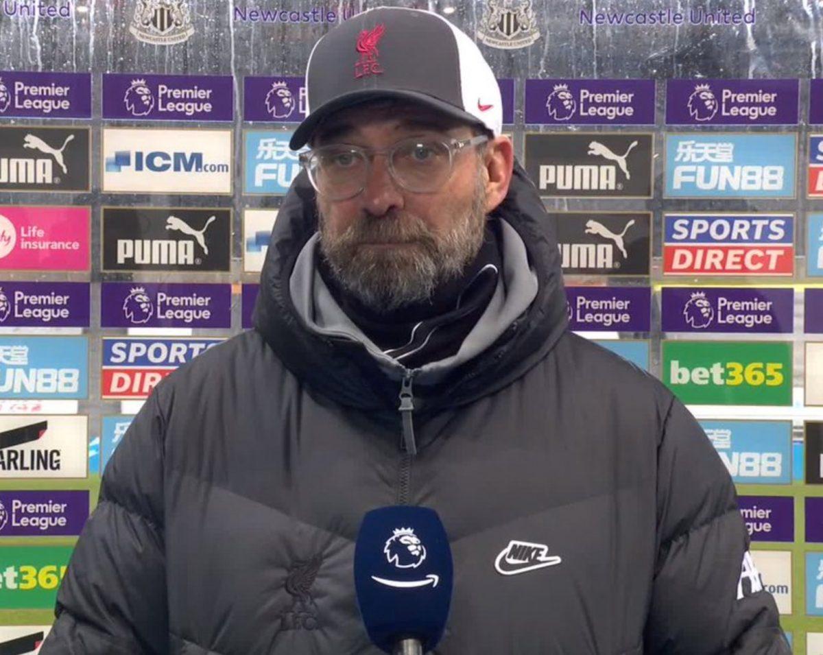 Jurgen Klopp gives post-match interview wearing a Nike jacket
