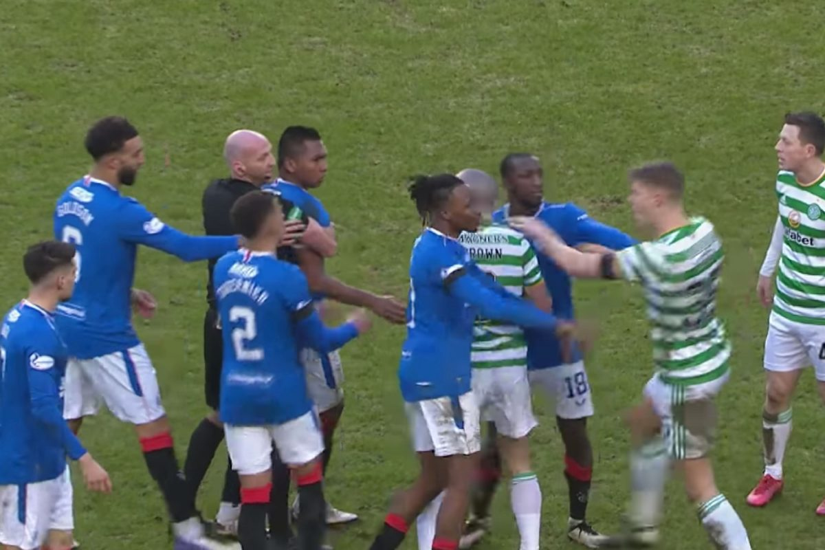 75th minute handbags between Celtic and Rangers as referee Bobby Madden holds Alfredo Morelos back