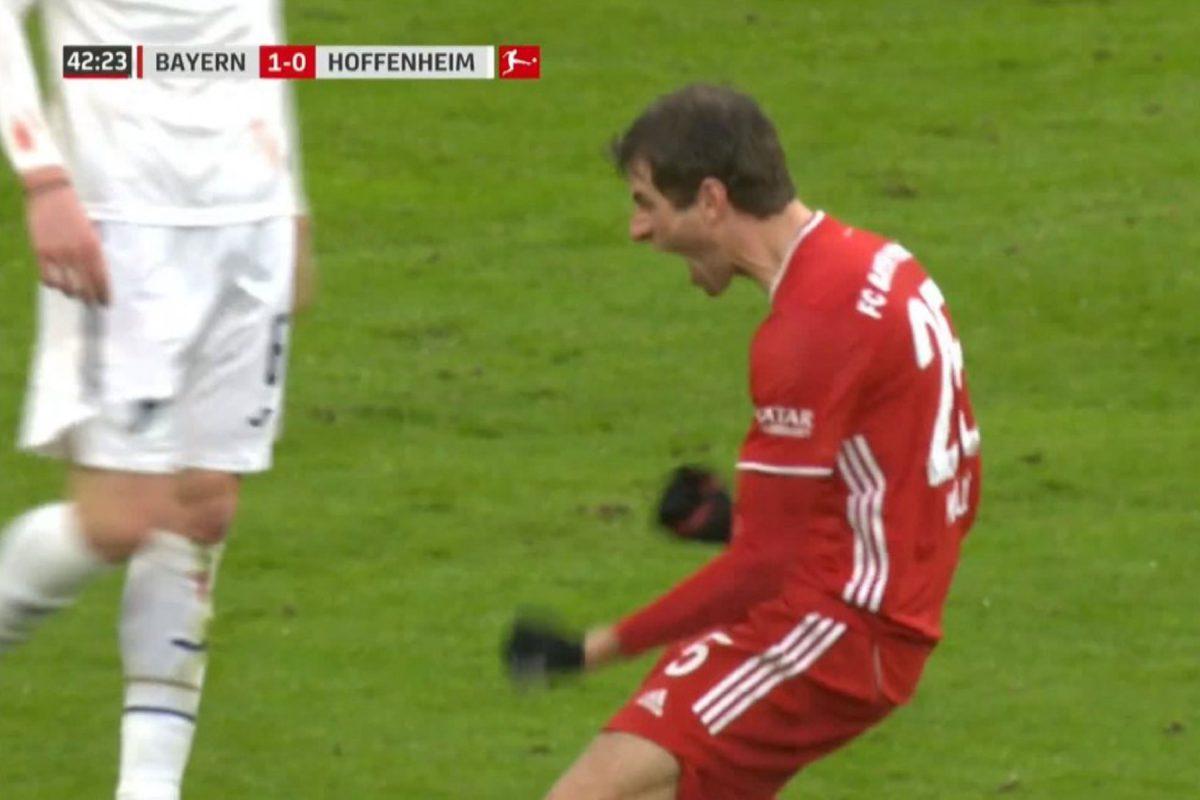 Thomas Muller celebrates scoring a goal against Hoffenheim