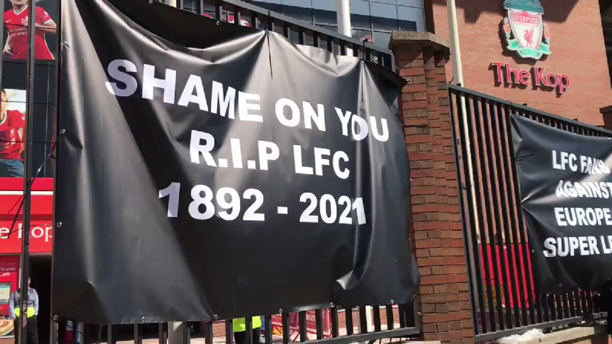 Liverpool fans protest against the Super League as 'RIP LFC' banner is hung outside Anfield