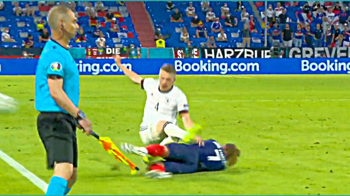 Antoine Griezmann launches a robust tackle on Matthias Ginter during France v Germany