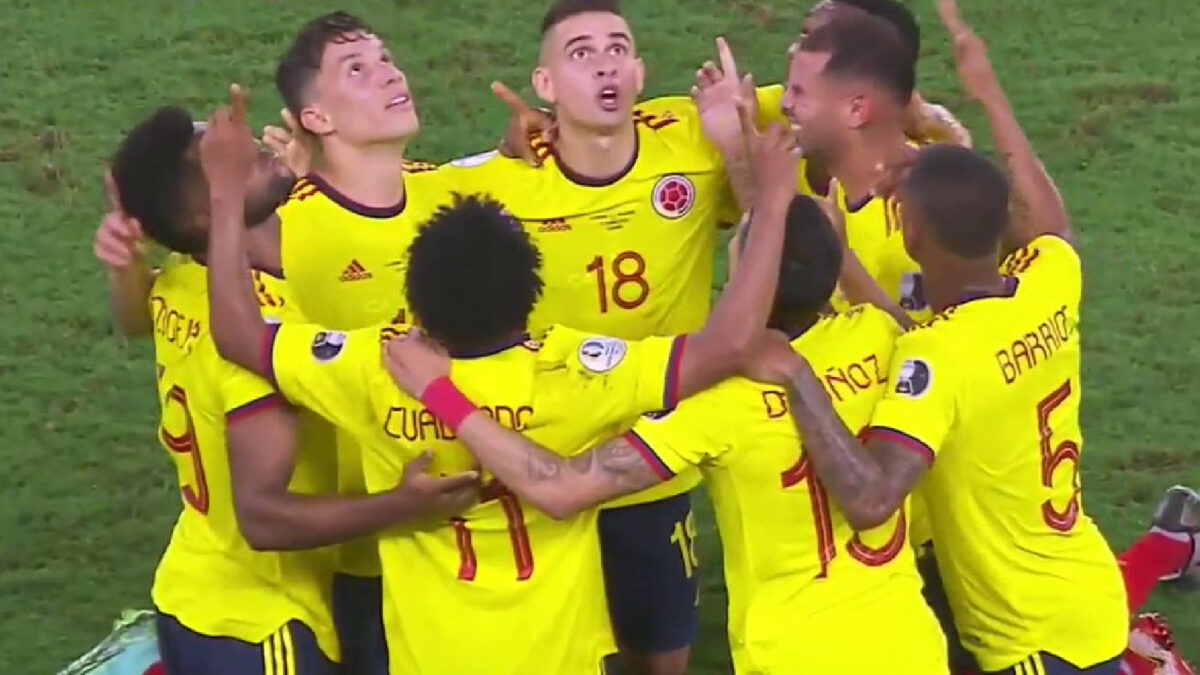 Colombia players reven in each other's company after scoring a phenomenal team goal against Ecuador