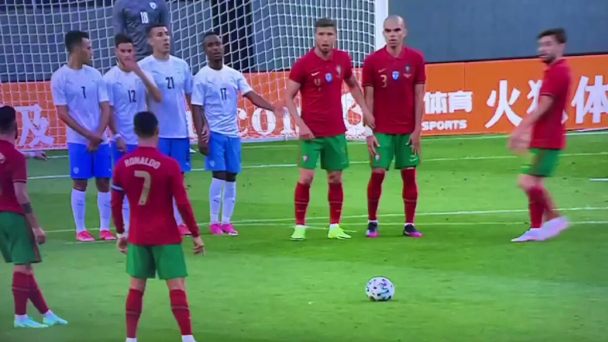 Cristiano Ronaldo taking his famous stance before skying his free-kick against Israel