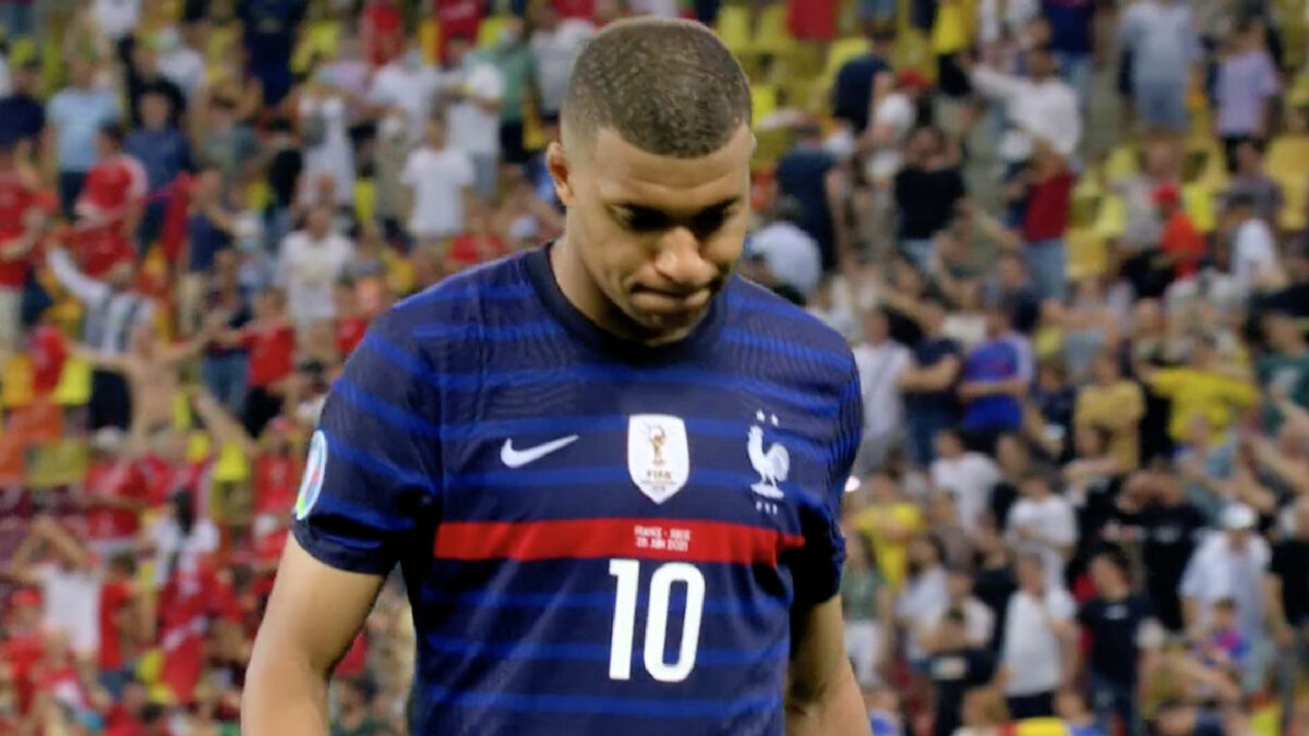 Kylian Mbappe hangs his head in shame after missing France's fifth penalty against Switzerland