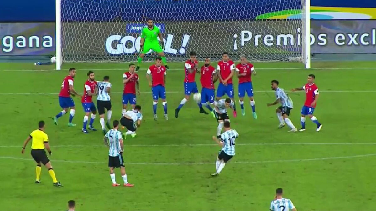 Lionel Messi in the process of scoring a picture perfect free kick against Chile