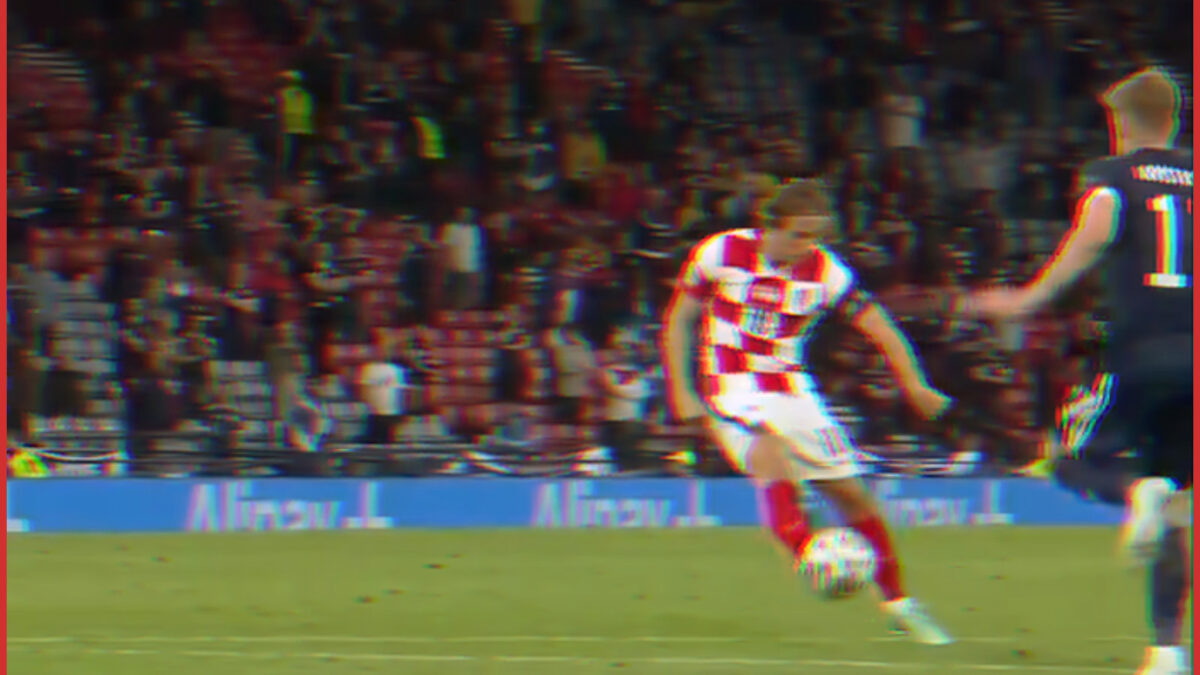 Luka Modric putting through an outside of the boot goal against Scotland