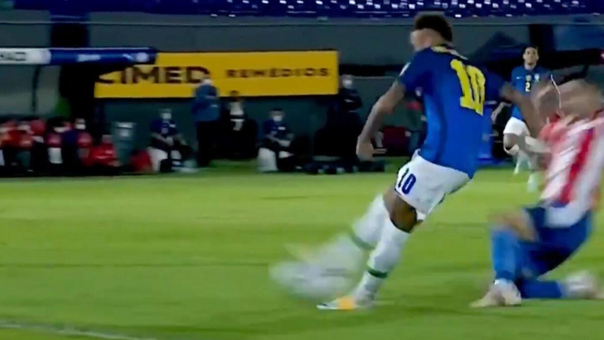 Neymar scoring a goal against Paraguay