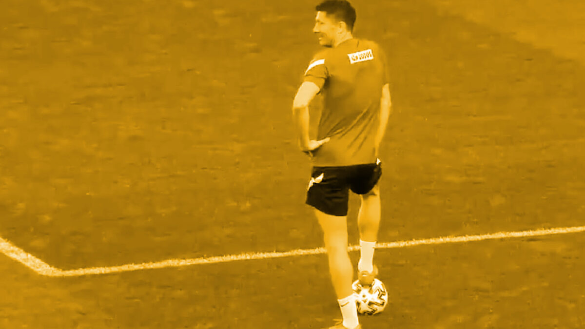 Robert Lewandowski basking in glory after knocking over a mobile phone from the hands of a Poland staffer in training