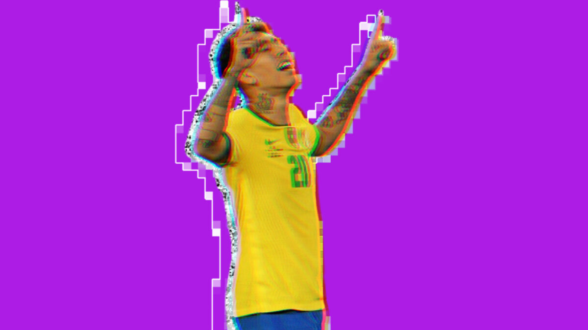 Roberto Firmino points to the gods after scoring a goal against Colombia