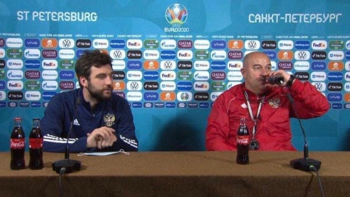 Russia manager Stanislav Cherchesov drinks Coke Zero during a press conference