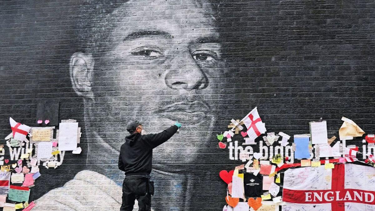 Akse repairing Marcus Rashford's mural in Withington