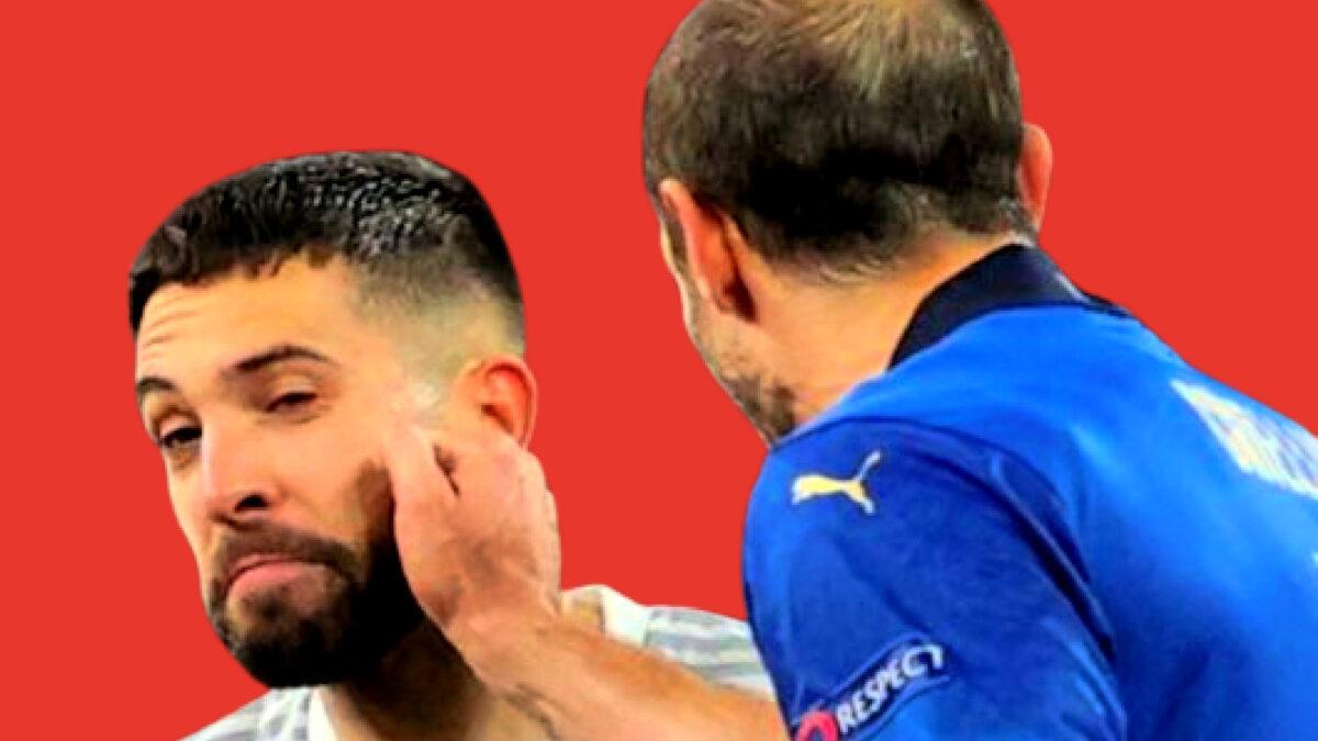Giorgio Chiellini playfully punching Jordi Alba in the face