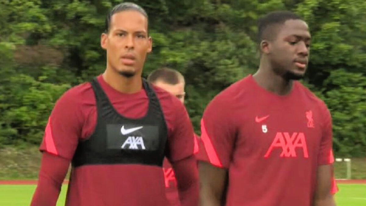Ibrahima Konate barely flinches as Virgil van Dijk nudges him in a playful yet competitive manner