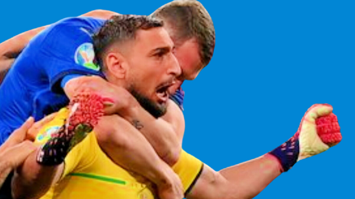 Italy players pile on Gianluigi Donnarumma after the Italy goalkeeper saves Bukayo Saka's penalty