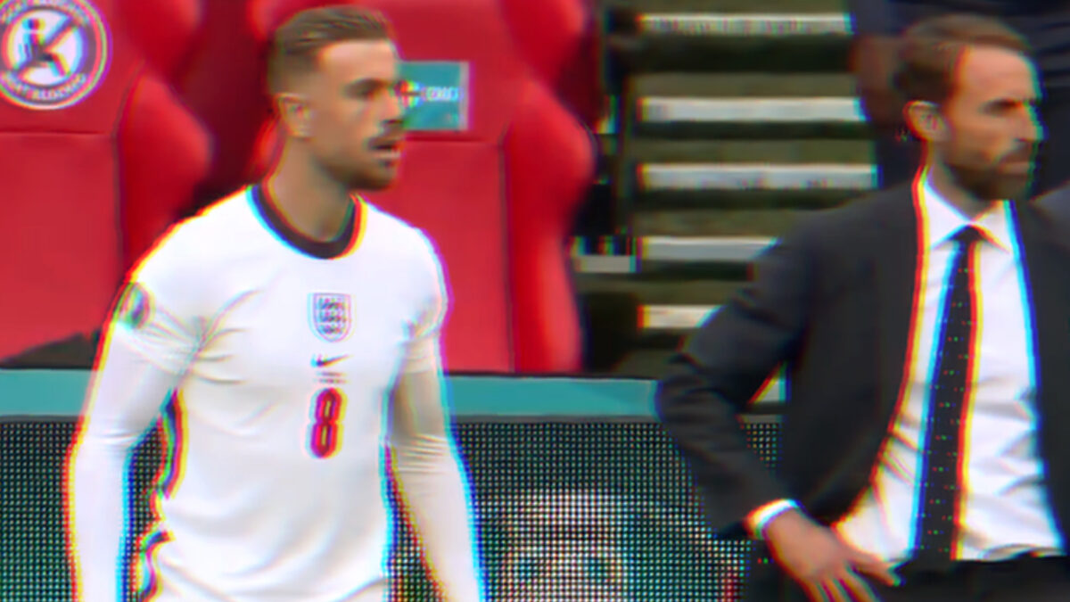Jordan Henderson and Gareth Southgate watch England score their second goal against Germany from the sidelines