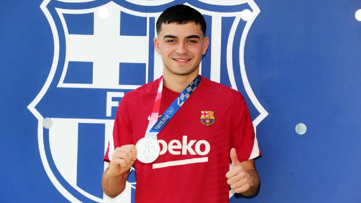 Pedri shows off his silver medal as he reports back to Barcelona training