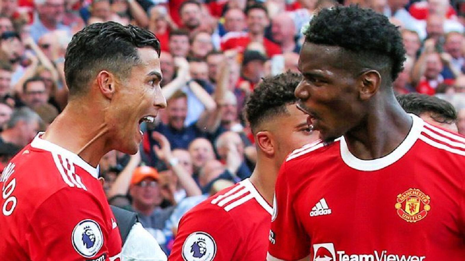 Cristiano Ronaldo celebrates with Paul Pogba
