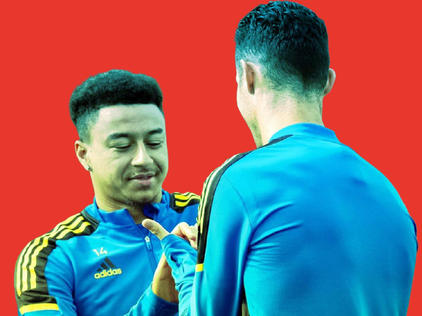 Jesse Lingard shows Cristiano Ronaldo how to do his own celebration