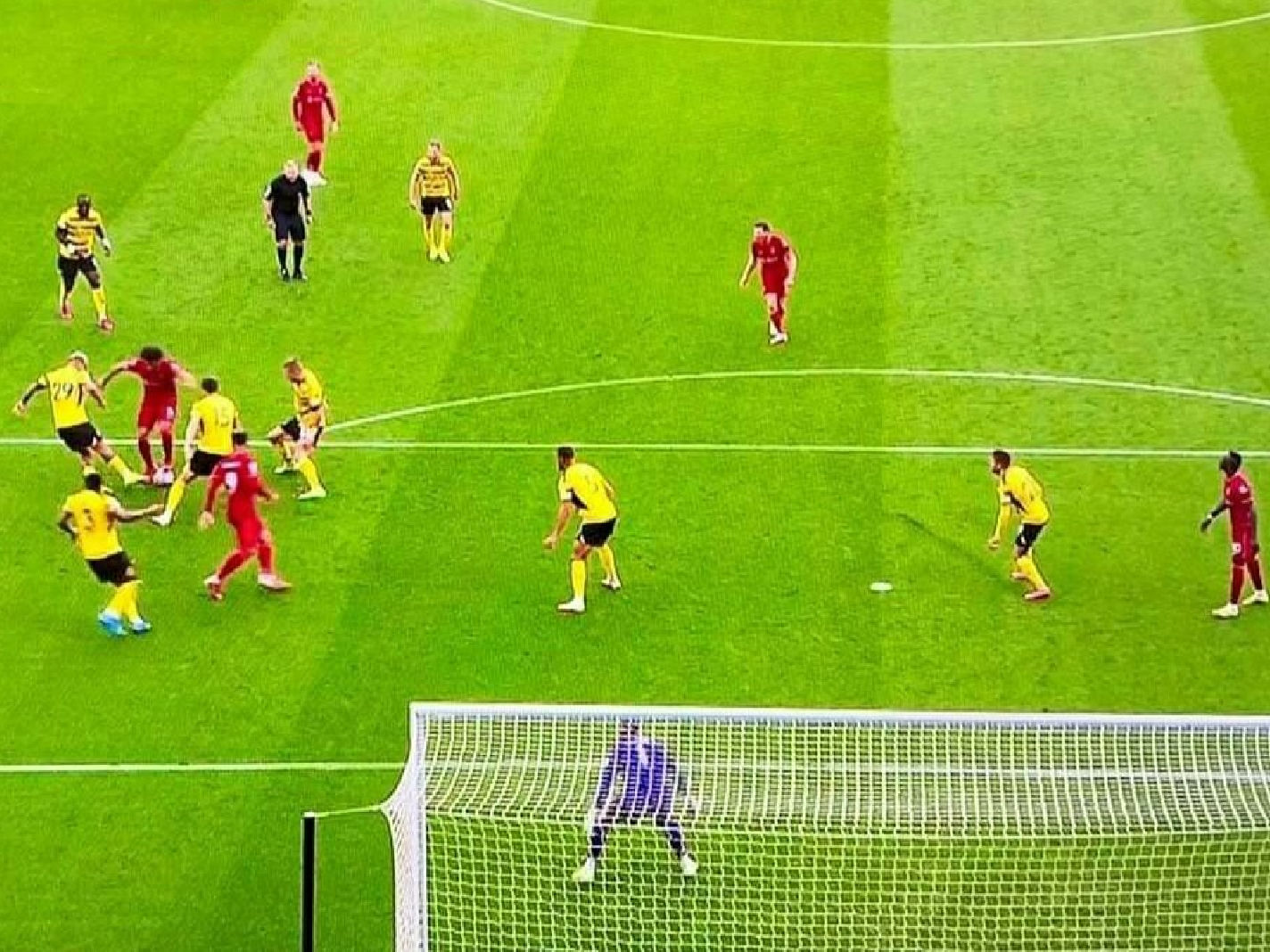 Mohamed Salah surrounded by Watford players before his goal